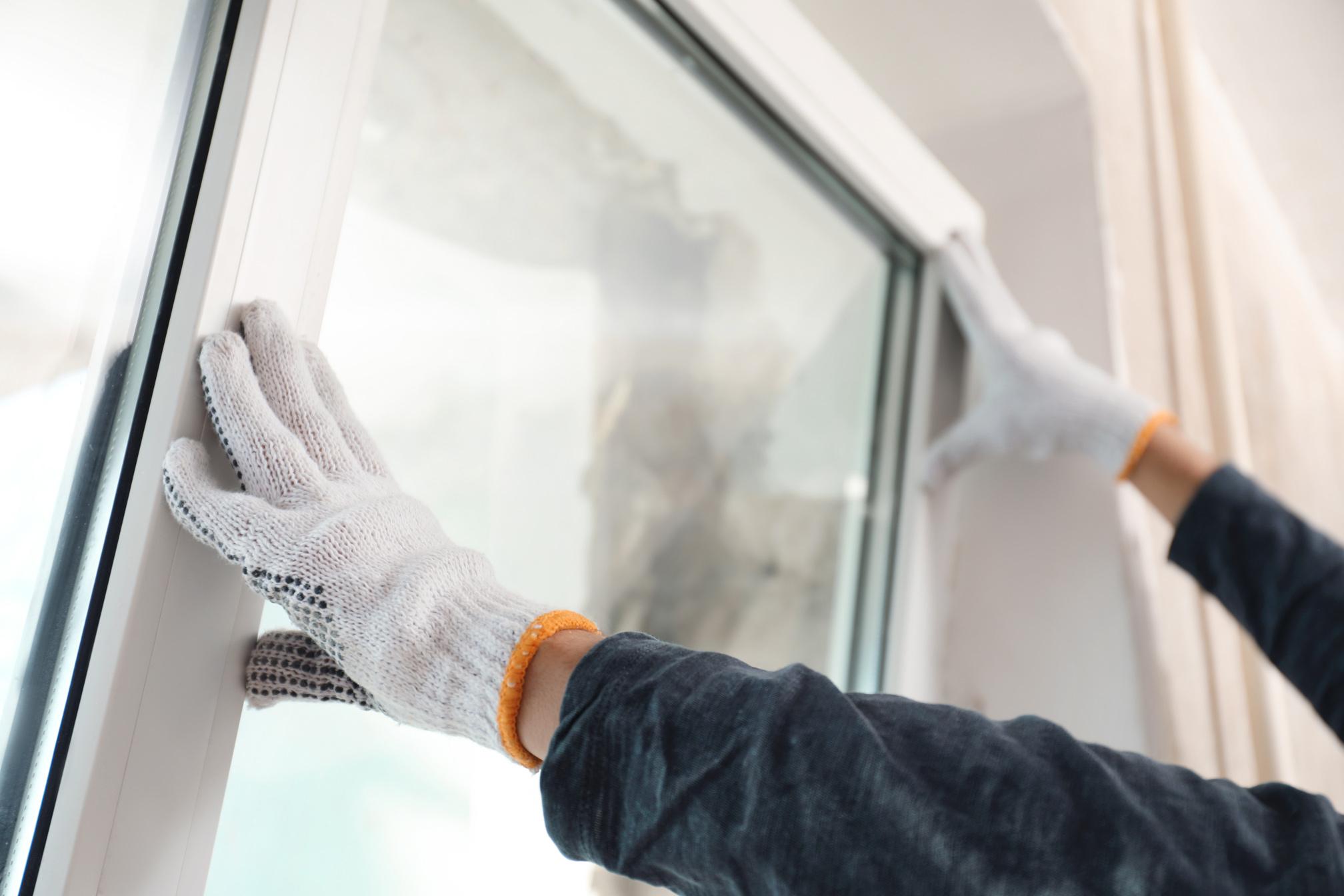 installing-double-glazed-window-house